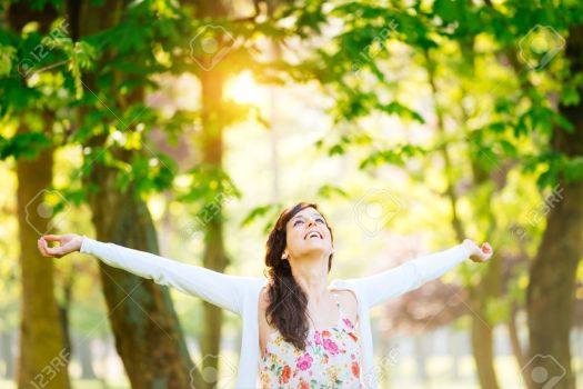 25510329-Blissful-woman-enjoying-freedom-and-life-in-park-on-spring--Stock-Photo