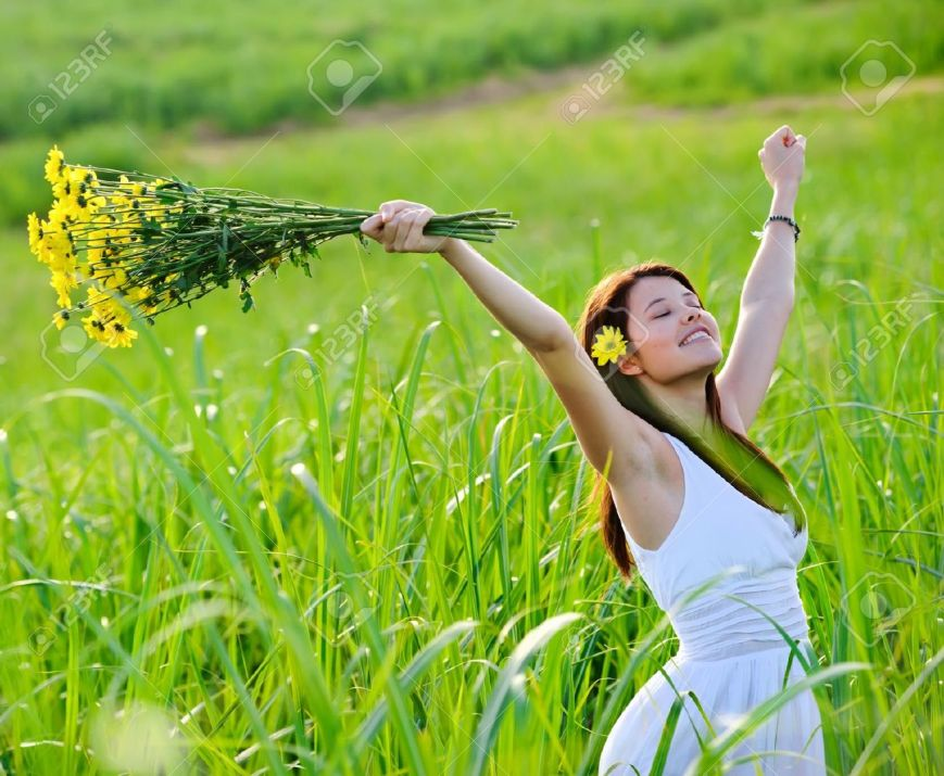 8726296-Carefree-adorable-girl-with-arms-out-in-field-summer-freedom-andjoy-concept--Stock-Photo