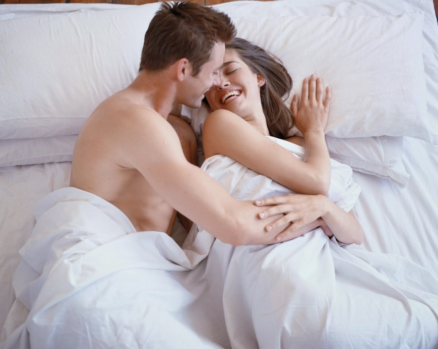 high angle view of a couple hugging in bed